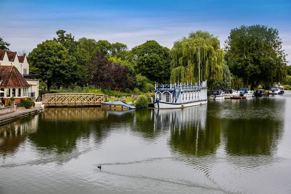 The Swan at Streatley Berkshire riverside hotel, decorative barge weeping willows