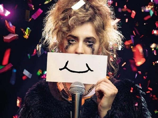 A super happy story about feeling super sad woman with eye liner round her eyes surrounded by confetti drawing on a smile depression