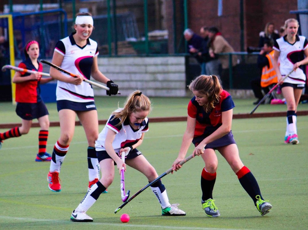 Lambrook School girls playing hockey match on all weather astro turf pitch