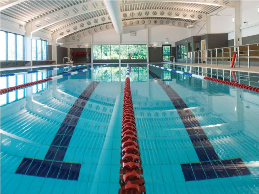 Lambrook School Berkshire 25m indoor pool with curved white roof and 6 lanes