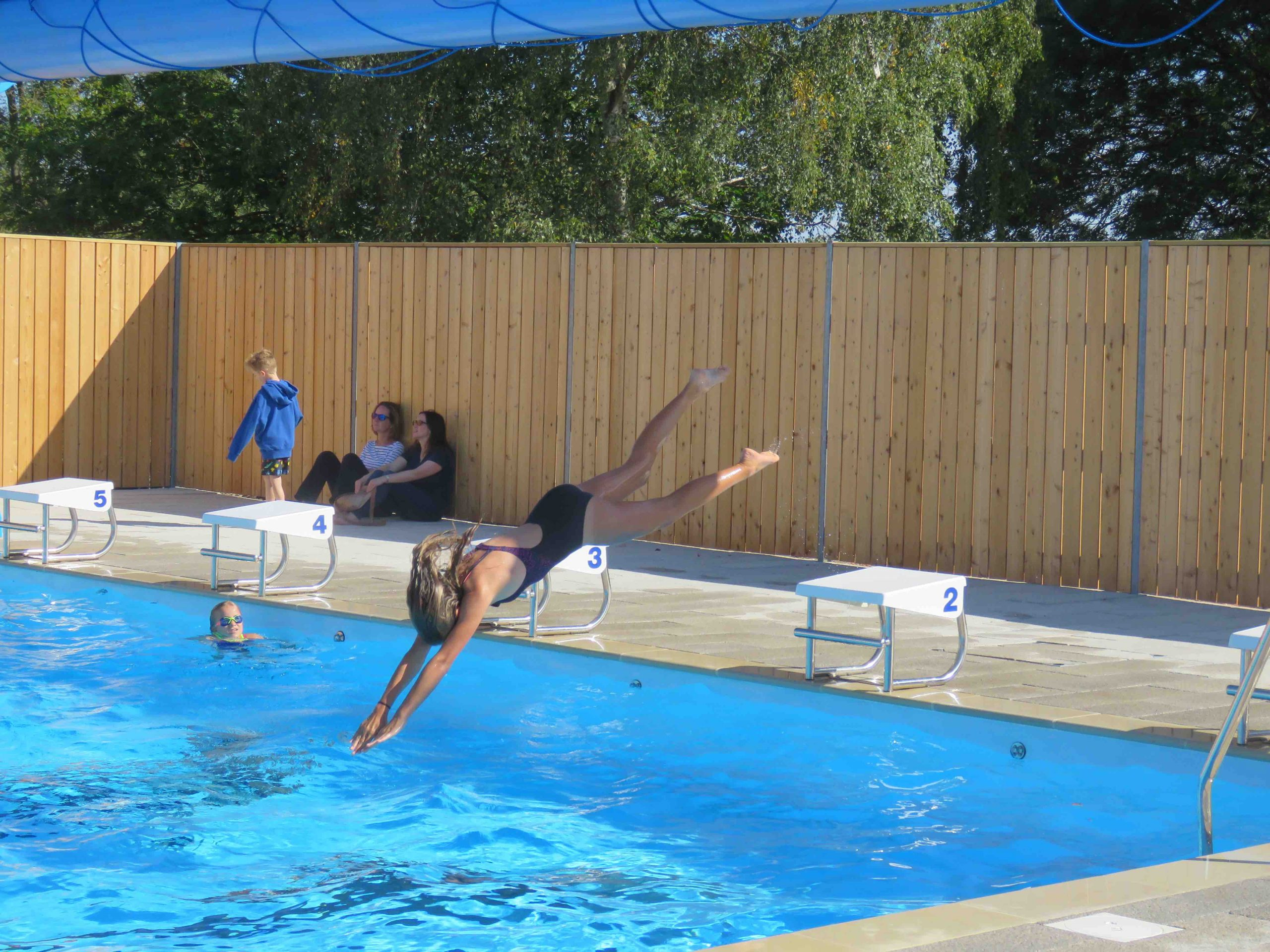 Girl diving into Pangbourne College Swimming Pool