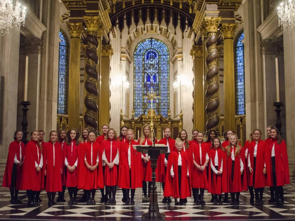 St George's Ascot Berkshire pupils of the Chapel Choir wearing traditional red capes gathered in St Paul's Cathedral to sing
