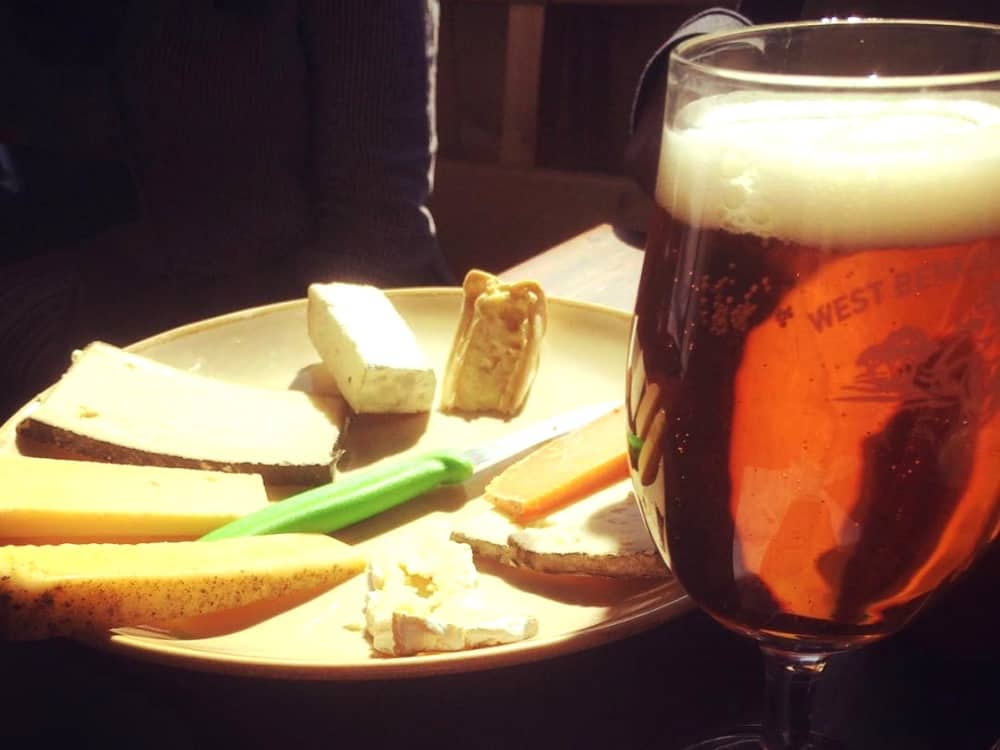 Pint of west berkshire beer plate of six cheeses Grumpy Goat West Berkshire Brewery