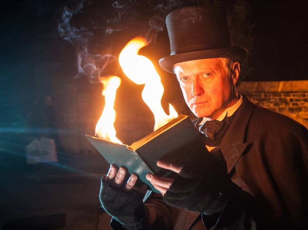 Oxford ghost story teller Bill Spectre top hat books and fire Stonor Park Henley