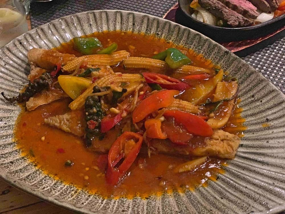 Giggling Squid Windsor leaf shaped plate with Sea bass and veggies in spicy sauce