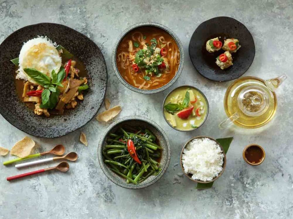 Giggling Squid Windsor Thai tapas bowls of different sharing dishes rice utensils and tea