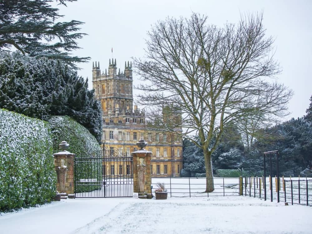 Highclere castle in snow with iron gates