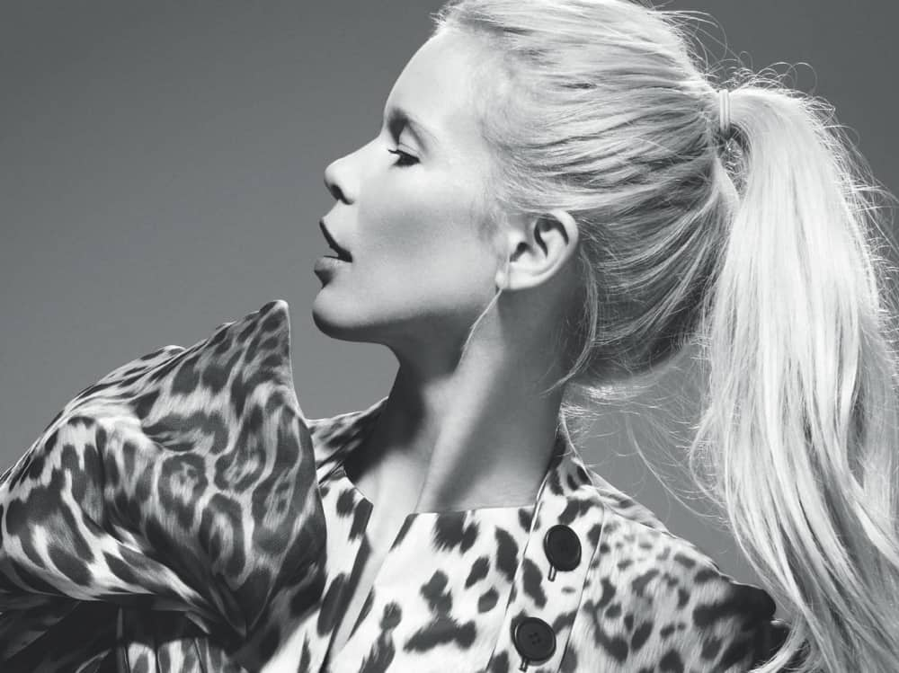 Leopard by Hilary Alexander black and white image of Claudia schiffer post tail and leopard print dress