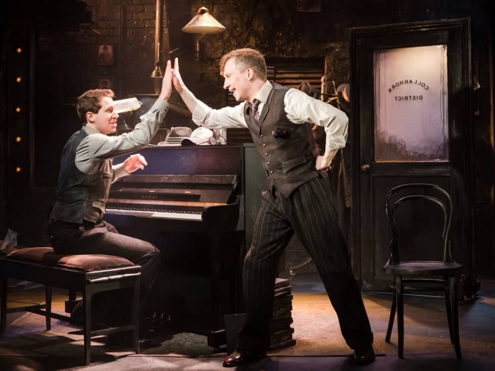 Murder for two play two actors high five. one stood up and the other sat at the piano