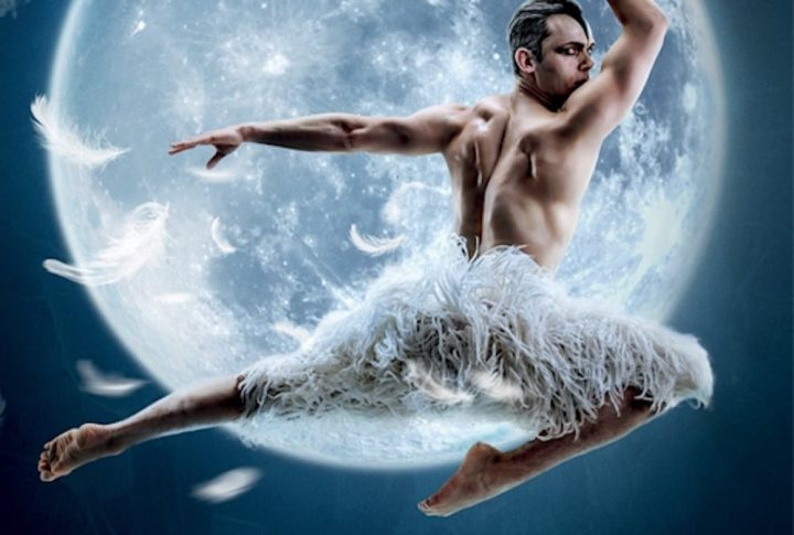 Matthew Bourne's Swan lake male swan leaping in feather trousers past the moon