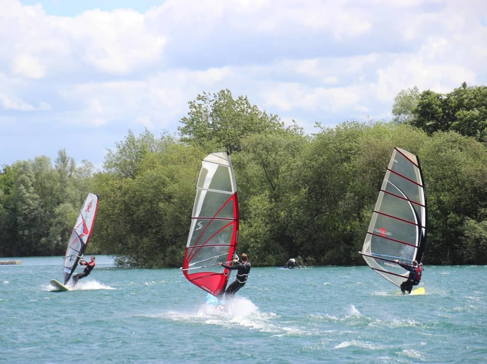 Trio of windsurfers on Bray Lake Berkshire