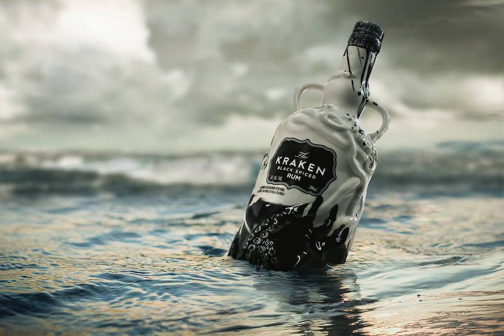 Bottle of Kraken rum bobbing in the sea