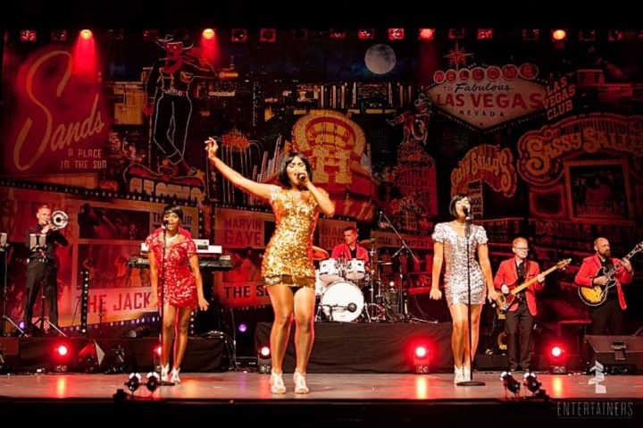 The Magic Of Motown Supremes tribute art tree dark haired women in sequin dresses on stage