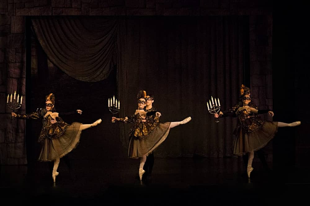 Ballet Theatre UK Beauty and the beast three dancers in last holding candelabras