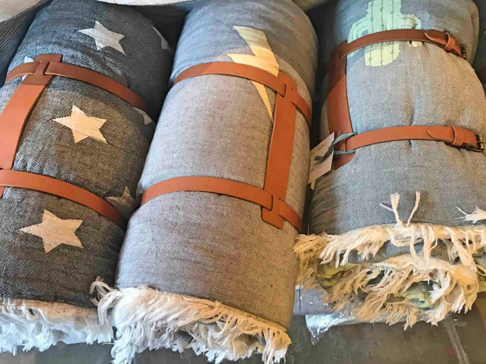 Rolled up throws lightening Catcus and stars with leather strap Corner Shop woolhampton
