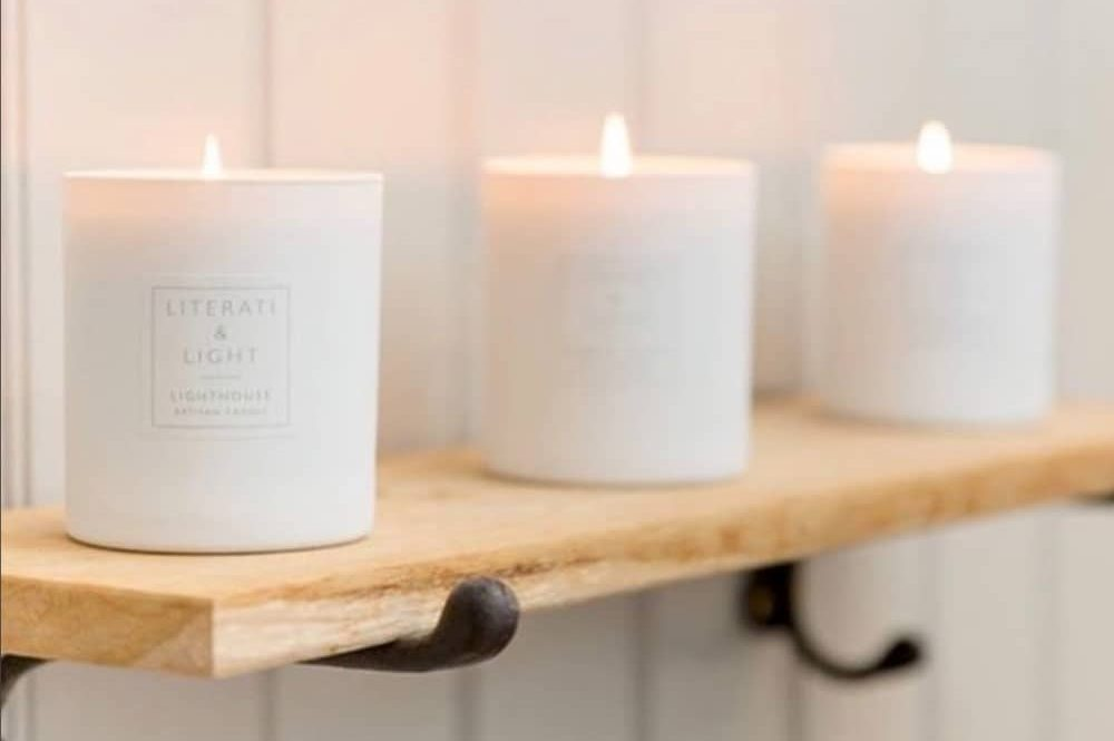 Literati and Light candles white glass jars on wooden shelf