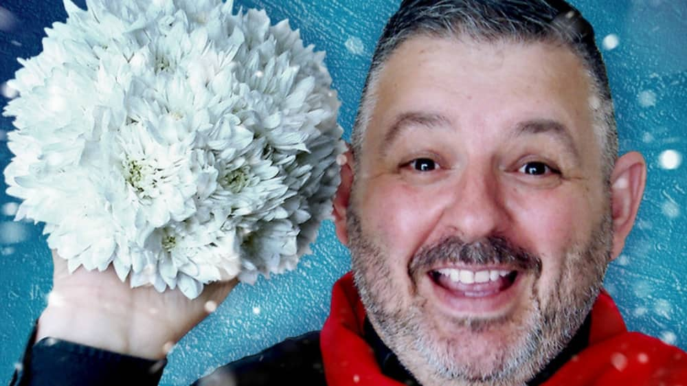 Floral designer Mig Kimpton wholding floral snow ball