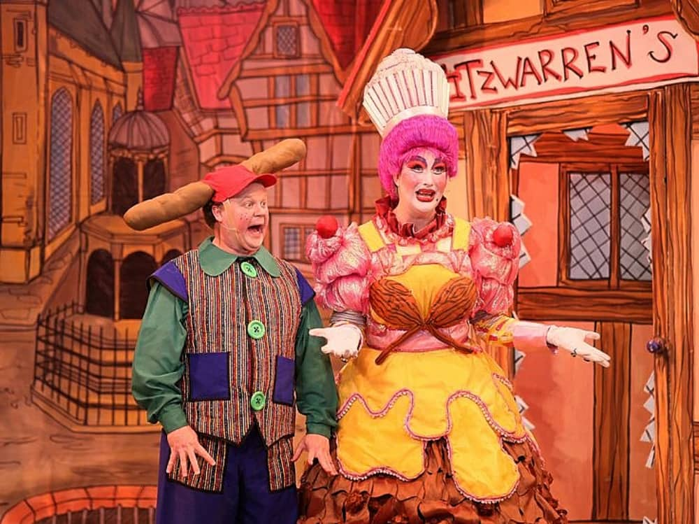 Cbeebie's star Justin fletcher wearing baguette in cap and stripe jacket Award winning dame Paul Morse pink wig chef's hat and pudding dress