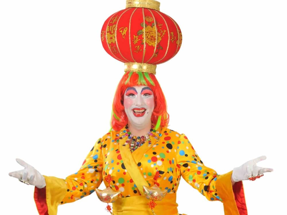 Paul Morse Panto Danme Reading Hexagon Theatre Berkshire mustard yellow spotted dress white gloves chinese lantern hat and orange hair