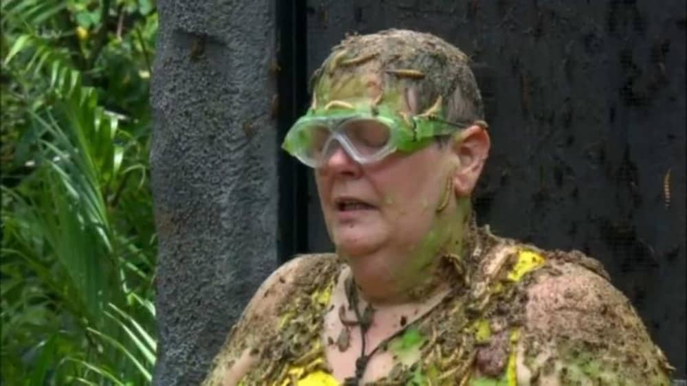 Anne Hegarty the chase star in I'm a celebrity wearing goggles cover in bugs