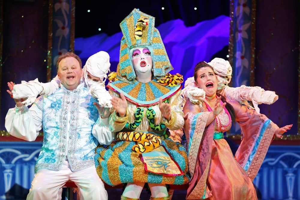 Aladdin Hexagon Reading Justin Fletcher dame dressed as egyptian pharaoh and so she with mummies