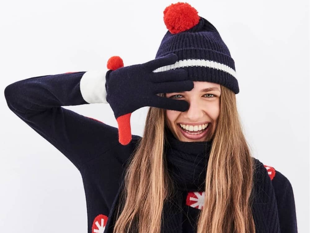 Chinti and parker navy sweater with red stars and wooly hat and scarf