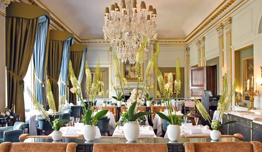 Cliveden Dining Room velvet curtains chairs and chandeliers