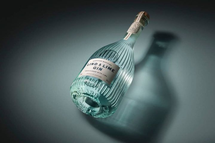 Lind and Lime Gin pale blue ribbed bottle lying on its side