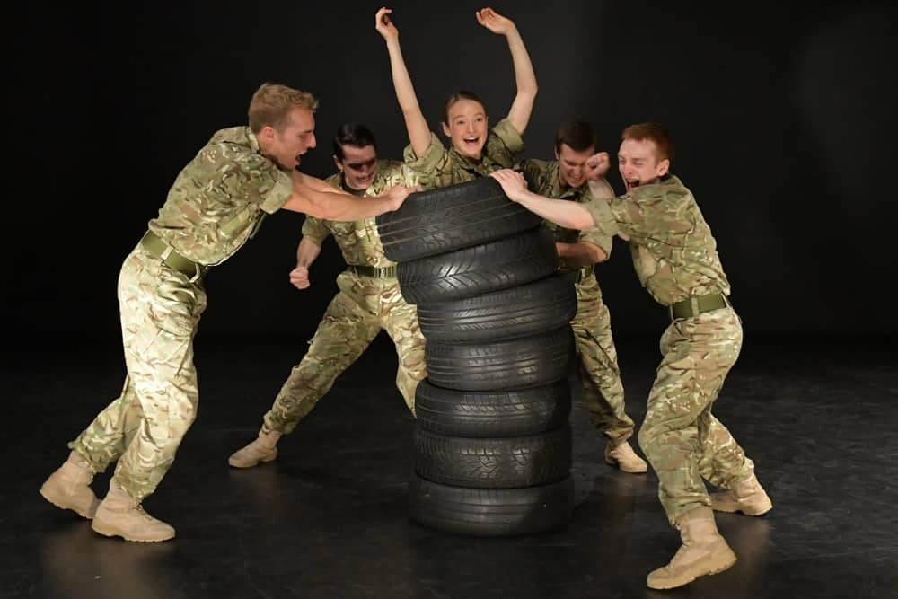 5 Soldiers dance performance female soldier in tyres surrounded by men