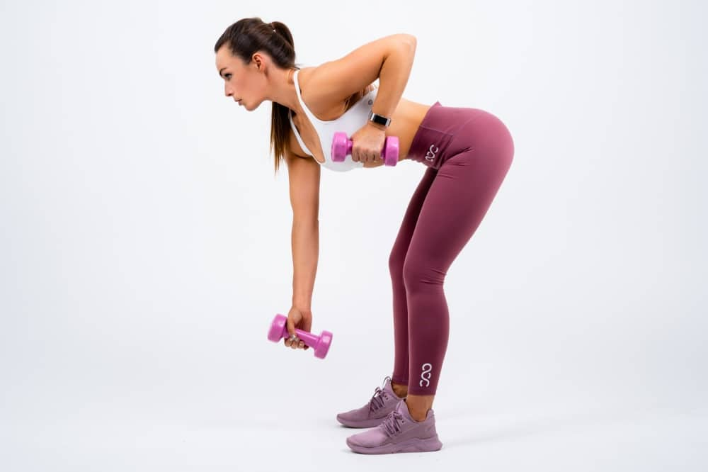 My Fit Zone woman bent over lifting hand weights