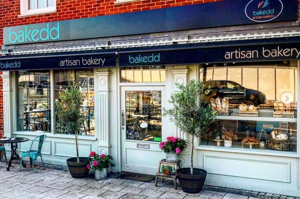 Bakedd artisan bakery and ca=fe maidenhead play blue exterior alice trees and roses by door