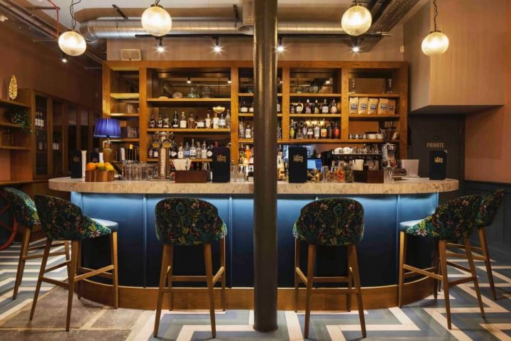 Corn Stores Reading Blues panelled bar green velvet bar stools