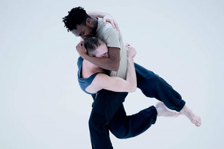 Epilogues Two male dancers embrace