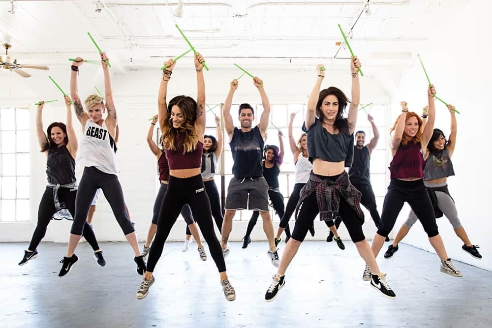 Pound class high energy fitness class with drum sticks Wellbeing Spirit