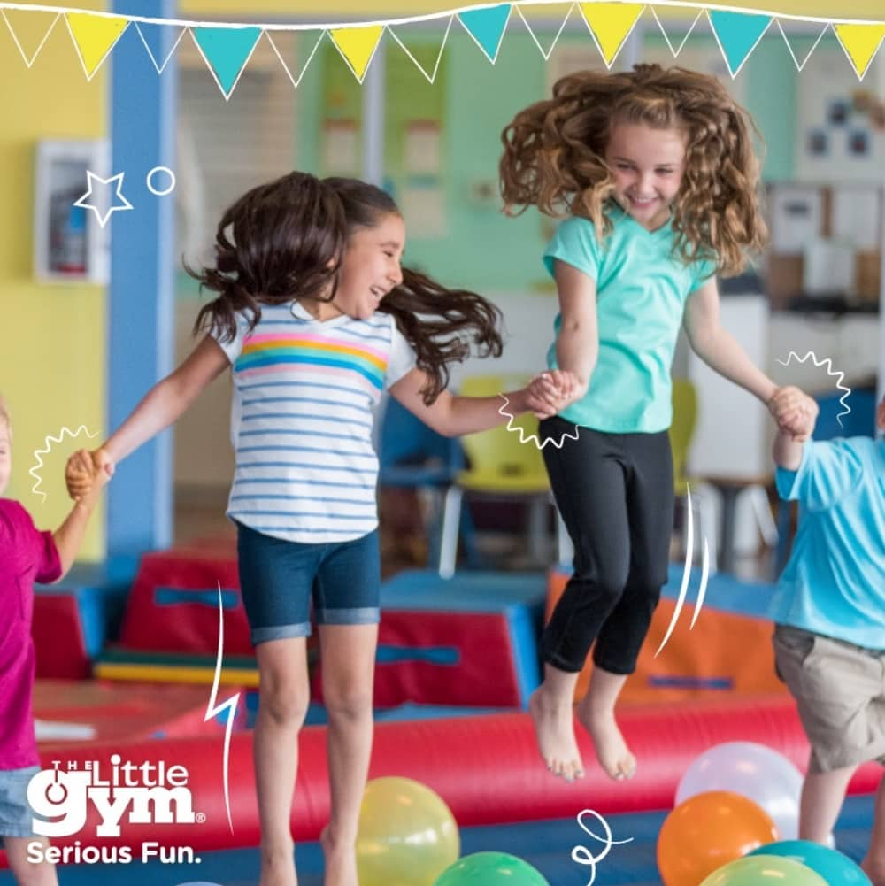 girls and boys bounce on trampoline at The Little Gym Windsor