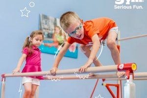 The Little Gym windsor boy glasses on parallel bars