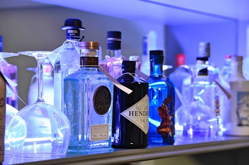 Park Spa Warbrook House Gin bottles on shelf blue light