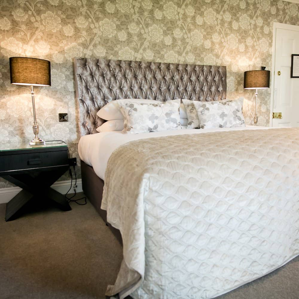 Warbrook House Hotel Luxury hotel room button backed headboard and neutral decor
