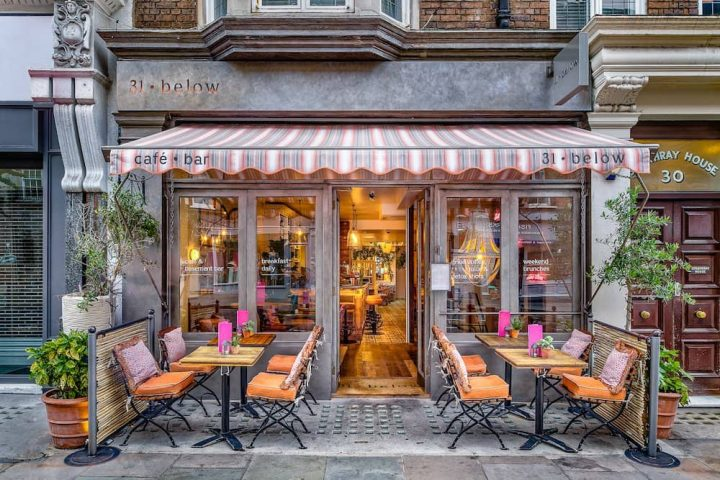 31 below Marylebone London bar cafe pink and grey awning outside tables and chairs