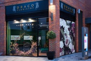 Draco Floristry shop Parkways Newbury black sign floral hoop display