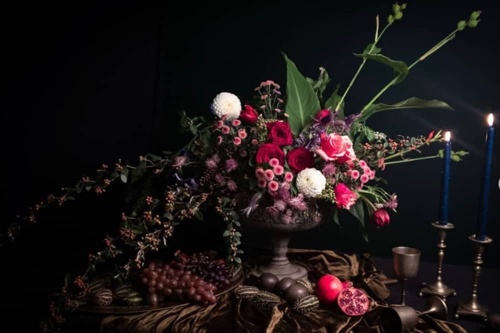 pink green and deep red floral display Dutch masters Draco Floristry