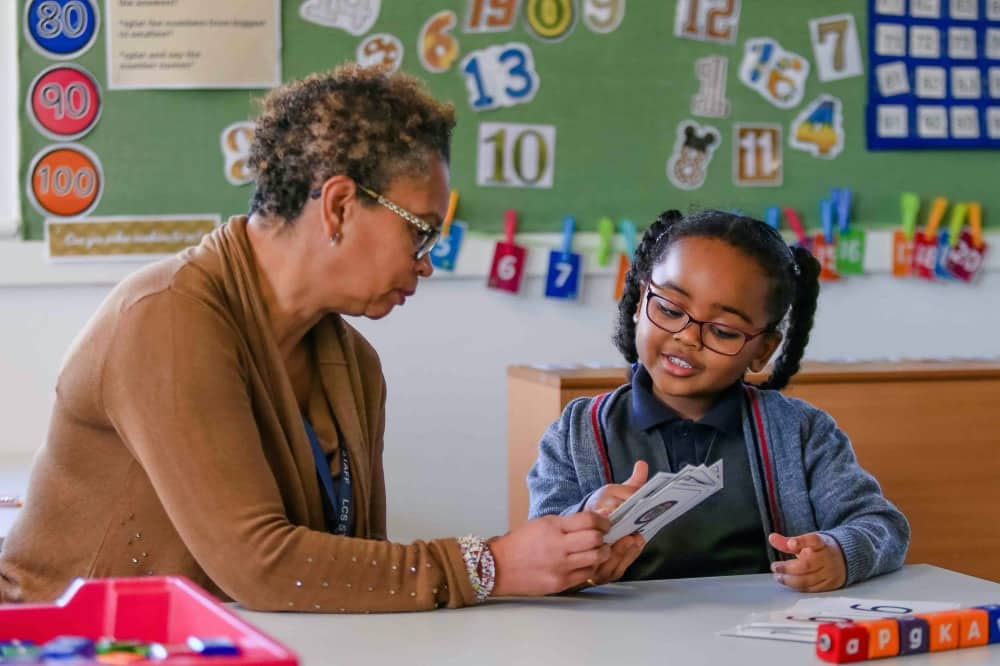 Long Close School classroom teacher reading to a child