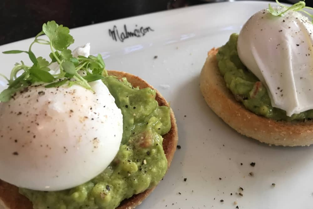 Poached eggs avocado muffin white plate MALMAISON READING brunch