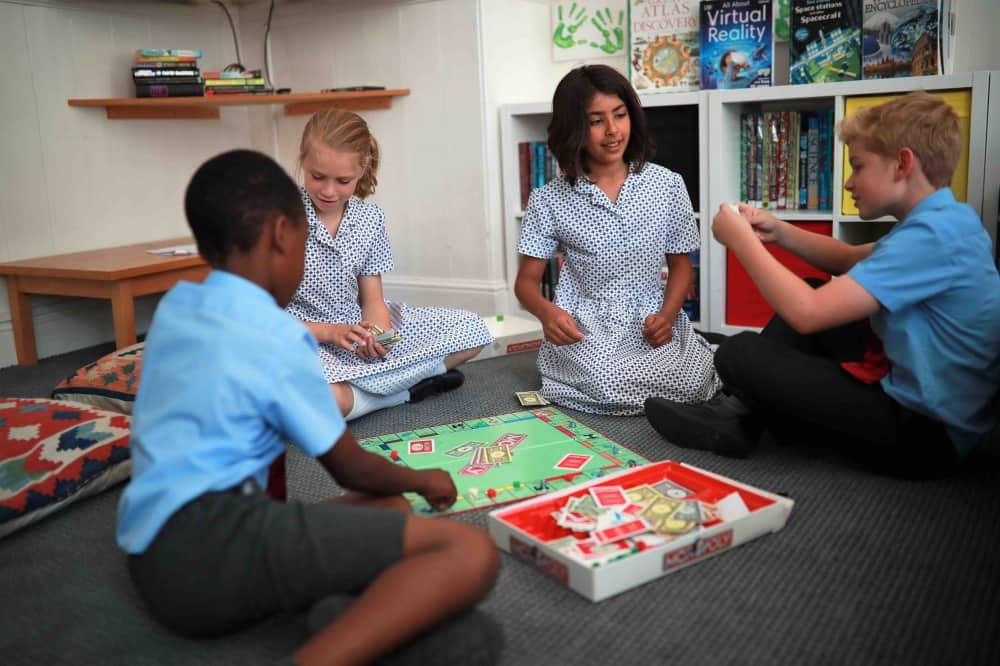 St George's Windsor children playing monopoly after school
