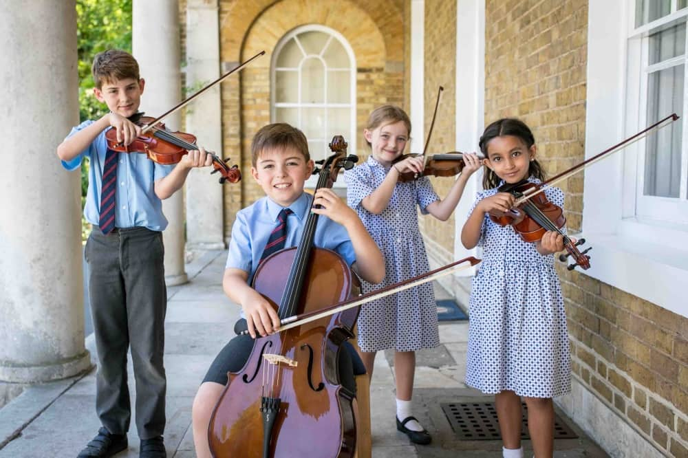 St George's School Windsor Castle children playing string instruments