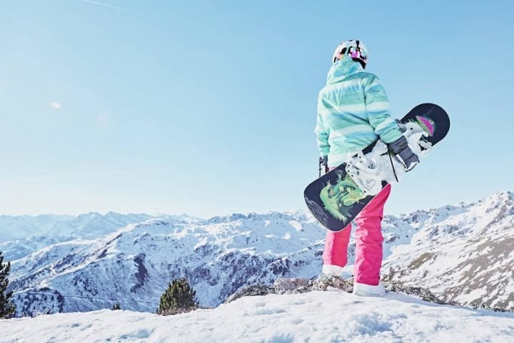 woman snowboarding on mountain