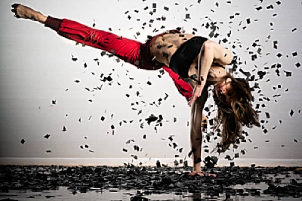 The Storm dancer red trousers balancing hand kicking up leaves