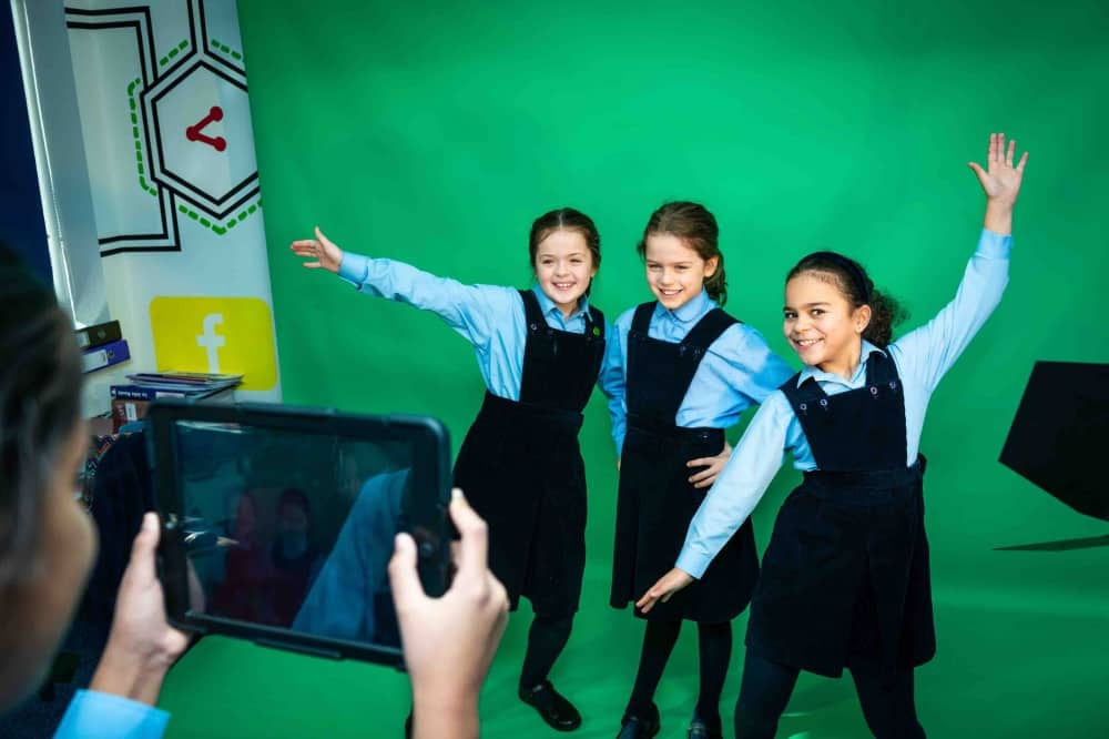 Upton House School windsor media suite green screen girls filming on iPad