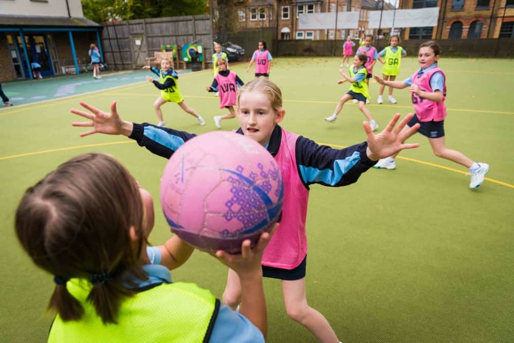 UPTON HOUSE netball training pink and yellow bibs astro court