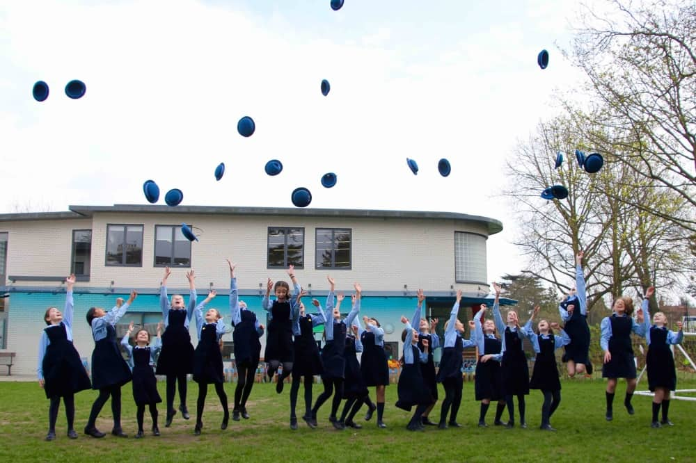 Upton House School Windsor Berkshire girls throwing hats in air celebrating success